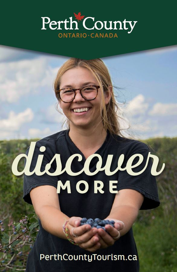 2018 Discover More Brochure Cover - Woman holding Blueberries