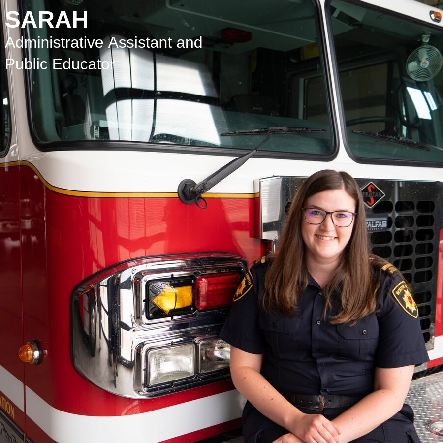 Brunette woman sitting on a red firetruck